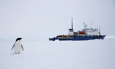 The Akademik Shokalskiy awaits the arrival of the Xue Long, in Antarctica.